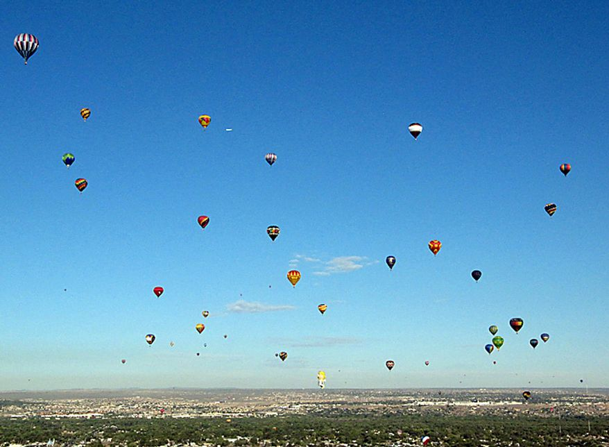 Hot air balloons lift off during the Albuquerque International Balloon Fiesta in Albuquerque, N.M., on Tuesday, Oct. 5, 2010. The annual event has attracted about 500 balloons and thousands of spectators. (AP Photo/Susan Montoya Bryan)