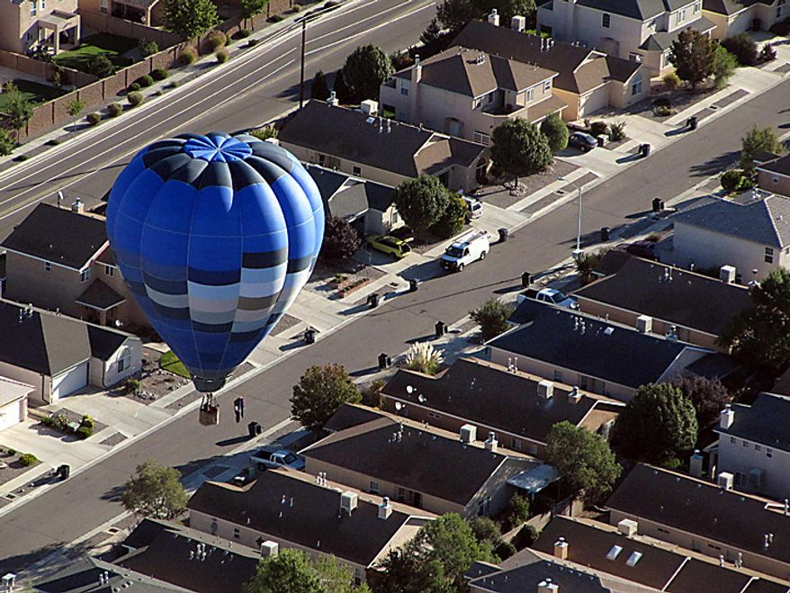 A hot air balloon looks for a spot to land in a neighborhood in Albuquerque, N.M., on Tuesday, Oct. 5, 2010. The annual Albuquerque International Balloon Fiesta has attracted about 500 balloons and thousands of spectators this week. (AP Photo/Susan Montoya Bryan)