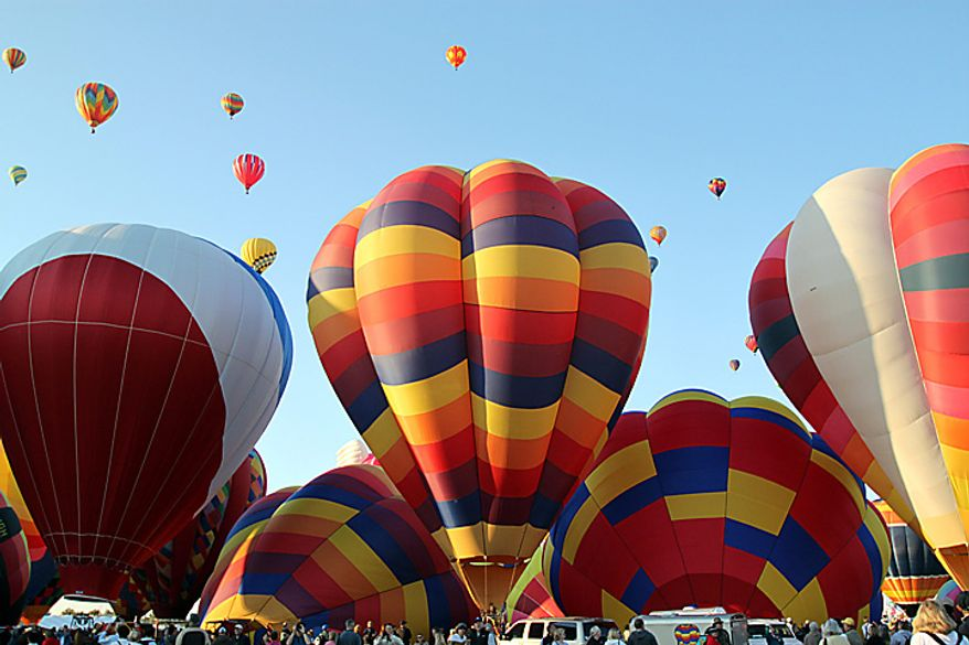 A hot air balloons inflate during the mass ascension at the Albuquerque International Balloon Fiesta in Albuquerque, N.M., on Saturday, Oct. 2, 2010. About 500 balloons were registered for the annual event. (AP Photo/Susan Montoya Bryan)