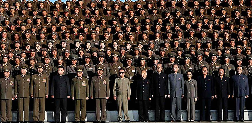 In this undated photo released on Wednesday, Oct. 6, 2010 by Korean Central News Agency via Korea News Service, North Korean leader Kim Jong Il wearing sunglasses at center front and his third son Kim Jong Un wearing black suit, standing third from Kim Jong Il's left, pose with North Korean soldiers who participated in  a coordinated drill of a military unit of the Korean People's Army at an undisclosed location in North Korea.  North Korea's heir apparent observed military drills with his father, according to a state media report Tuesday, heralding a growing public profile for Kim Jong Un as he takes on a more prominent role in the reclusive nation. Chief of the General Staff of the Korean People's Army Ri Yong Ho stands at first from Kim Jong Il's left and Defense Chief Kim Yong Chun stands at second from Kim Jong Il's left. Kim Jong Il's younger sister, Kim Kyong Hui, a general in the Korean People's Army, stands at 4th right in front, and her husband Jang Song Thaek stands at right in front. (AP Photo/Korean Central News Agency via Korea News Service)