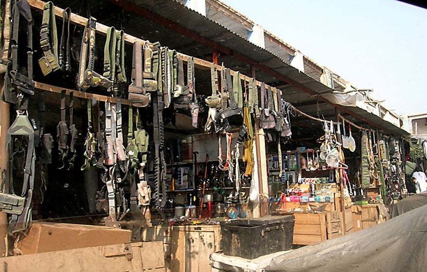 In this picture taken on Oct. 5, 2010, looted goods are on sale at a market on the outskirts of Peshawar, Pakistan. Baseballs, army-issue computers, pocket books telling American soldiers how to avoid roadside bombs and hundreds of other items stolen from NATO and U.S. containers crossing through Pakistan are openly sold at a market in this town. (AP Photo)