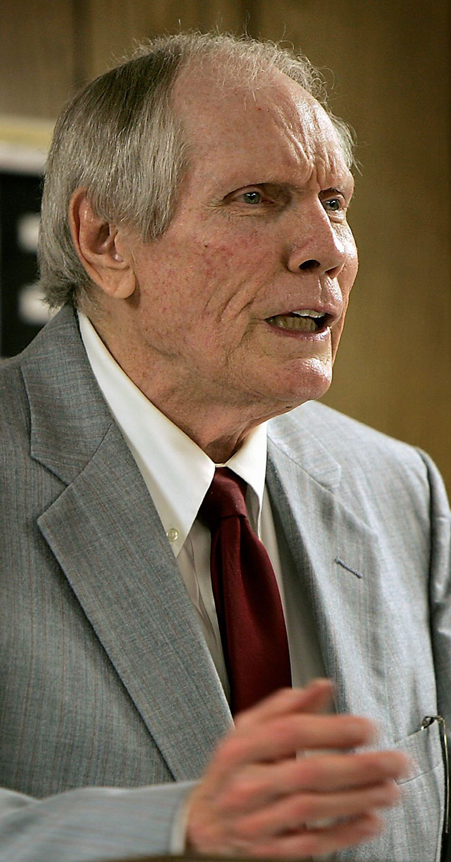"In a March 19, 2006 file photo, Pastor Fred Phelps preaches at his Westboro Baptist Church in Topeka, Kan.  Albert Snyder of York, Pa., the father of a Marine killed in Iraq, is asking the Supreme Court to reinstate a $5 million verdict against members of the Westboro Baptist Church of Topeka, Kan., led by the Rev. Fred Phelps, who picketed his son's funeral with signs like ""Thank God for Dead Soldiers"" and ""God Hates the USA."" The U.S. Supreme Court is hearing arguments Wednesday, Oct. 6, 2010 in the dispute between Snyder and members of the Westboro Baptist Church. The case pits Snyder's right to grieve privately against the church members' right to say what they want, no matter how offensive. (AP Photo/Charlie Riedel, File)"