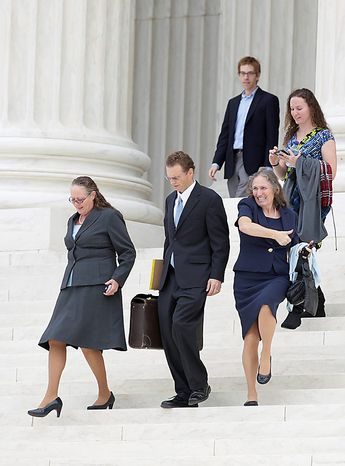 Shirley Phelps-Roper of the Westboro Baptist Church, of Tokepa Kan., lower right, celebrates as she walks down the steps of the Supreme Court in Washington, Wednesday, Oct. 6, 2010,with Margie Phelps, left, the lawyer  and church member who argued the case for the Westboro Baptist Church, after the court heard arguments in the dispute between Albert Snyder, of York, Pa., and the Westboro Baptist Church.  (AP Photo/Carolyn Kaster)