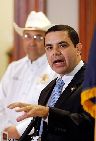 Rep. Henry Cuellar, Texas Democrat (right), and Zapata County Sheriff Sigifredo Gonzalez discuss the disappearance of David Hartley in Mexico. (Associated Press)