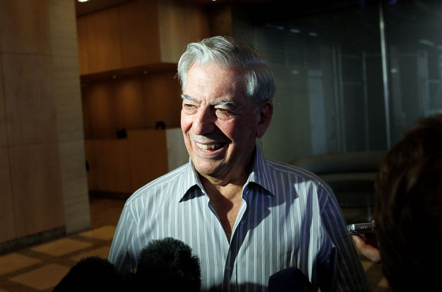 """Winning the Nobel Prize for literature """"is totally unexpected, a real surprise,"""" Mario Vargas Llosa tells reporters. (Associated Press)"""