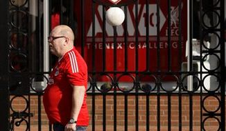"The gates of Liverpool Football Club's Anfield Stadium is seen on the day that the club's possible sale has been announced, Liverpool, England, Wednesday Oct. 6, 2010.  Liverpool's board agreed to sell the debt-riddled Premier League soccer  club to the owners of the Boston Red Sox on Wednesday, although legal action may be needed to force the existing American owners out. Current co-owners Tom Hicks and George Gillett Jr. said Tuesday they would resist the bid from New England Sports Ventures, which owns the Red Sox, and a separate bid from Asia because both ""dramatically undervalue"" the 18-time English champions. (AP Photo/Jon Super)"
