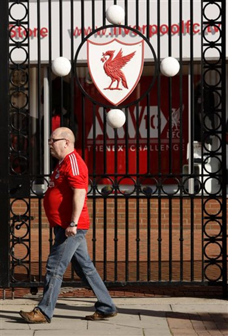 """The gates of Liverpool Football Club's Anfield Stadium is seen on the day that the club's possible sale has been announced, Liverpool, England, Wednesday Oct. 6, 2010.  Liverpool's board agreed to sell the debt-riddled Premier League soccer  club to the owners of the Boston Red Sox on Wednesday, although legal action may be needed to force the existing American owners out. Current co-owners Tom Hicks and George Gillett Jr. said Tuesday they would resist the bid from New England Sports Ventures, which owns the Red Sox, and a separate bid from Asia because both """"dramatically undervalue"""" the 18-time English champions. (AP Photo/Jon Super)"""