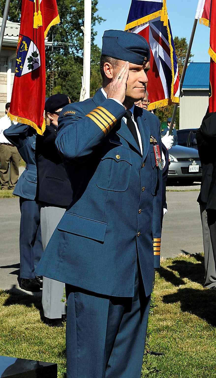 ** FILE ** Col. Russell Williams salutes as he arrives at the Battle of Britain parade in Trenton, Ontario, in September 2009. Michael Edelson, Col. Williams' lawyer, told a judge on Thursday, Oct. 7, 2010, that his client intends to plead guilty to murder, sexual assault and dozens of breaking-and-entering charges at his next court appearance Oct. 18. (AP Photo/Canadian Department of National Defense via Canadian Press)