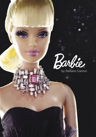 This April 2010 photo provided by Canturi Jewels shows international fine jewelry designer Stefano Canturi creating a custom-designed Barbie in his studio in Sydney, Australia. The Barbie is wearing a necklace featuring a one-carat pink diamond, which will make the doll the world's most expensive Barbie when it goes on the auction block. On Oct. 20, 2010, Christie's in New York will sell the Barbie for an estimated $300,000 to $500,000. All proceeds will benefit The Breast Cancer Research Foundation in support of Breast Cancer Awareness Month. (AP Photo/Canturi Jewels) NO SALES