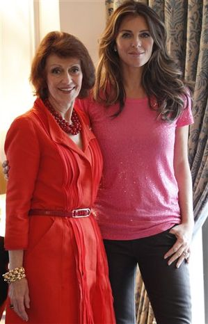 This Sept. 30, 2010 photo shows Evelyn Lauder, left, and Elizabeth Hurley as they pose for a photo after an interview with the Associated Press in New York. The breast cancer awareness-movement's dynamic duo, Evelyn Lauder and Elizabeth Hurley, are both well into their second decade of promoting the pink ribbon, matching lipsticks and mammograms. But the audience for their messages is evolving in front of their eyes: Instead of convincing people to talk about breast cancer, they find themselves courting a generation of young women who've never thought the subject was taboo in the first place.    (AP Photo/Mary Altaffer)