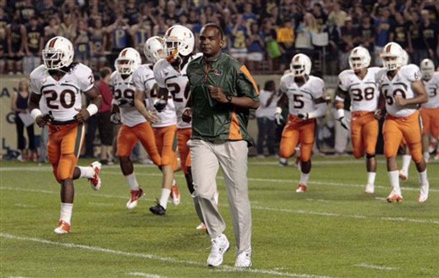 FILE - in this Sept. 23, 2010, file photo, Miami coach Randy Shannon, center, leads his team onto the field for an NCAA college football game against Pittsburgh in Pittsburgh.  Florida State's defense last year? Brutal at times. Miami's defense last year? Inconsistent at best. This year, it's all different for both, as the Seminoles are stifling and the Hurricanes are swarming heading into their Sunshine State showdown Saturday. (AP Photo/Keith Srakocic, File)