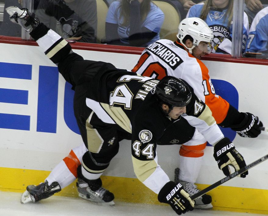 ASSOCIATED PRESS Pittsburgh Penguins defenseman Brooks Orpik (44) collides with Philadelphia Flyers' Mike Richards during the first period of an NHL hockey game in Pittsburgh, Thursday, Oct. 7, 2010.
