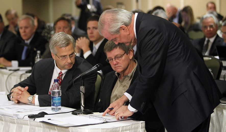 Daniel Oldfather (center), a Weatherford cementation service operator, reviews a document with Weatherford lawyer Michael Lemoine (left) and Halliburton lawyer Donald Godwin (right) while being questioned during the Deepwater Horizon joint investigation hearings held by the U.S. Coast Guard and the Bureau of Ocean Management Regulation and Enforcement in Metairie, La., on Thursday, Oct. 7, 2010. (AP Photo/Patrick Semansky, Pool)