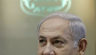 Israeli Prime Minister Benjamin Netanyahu attends the weekly cabinet meeting in Jerusalem, Monday, Oct. 4, 2010. (AP Photo/Ammar Awad , Pool)