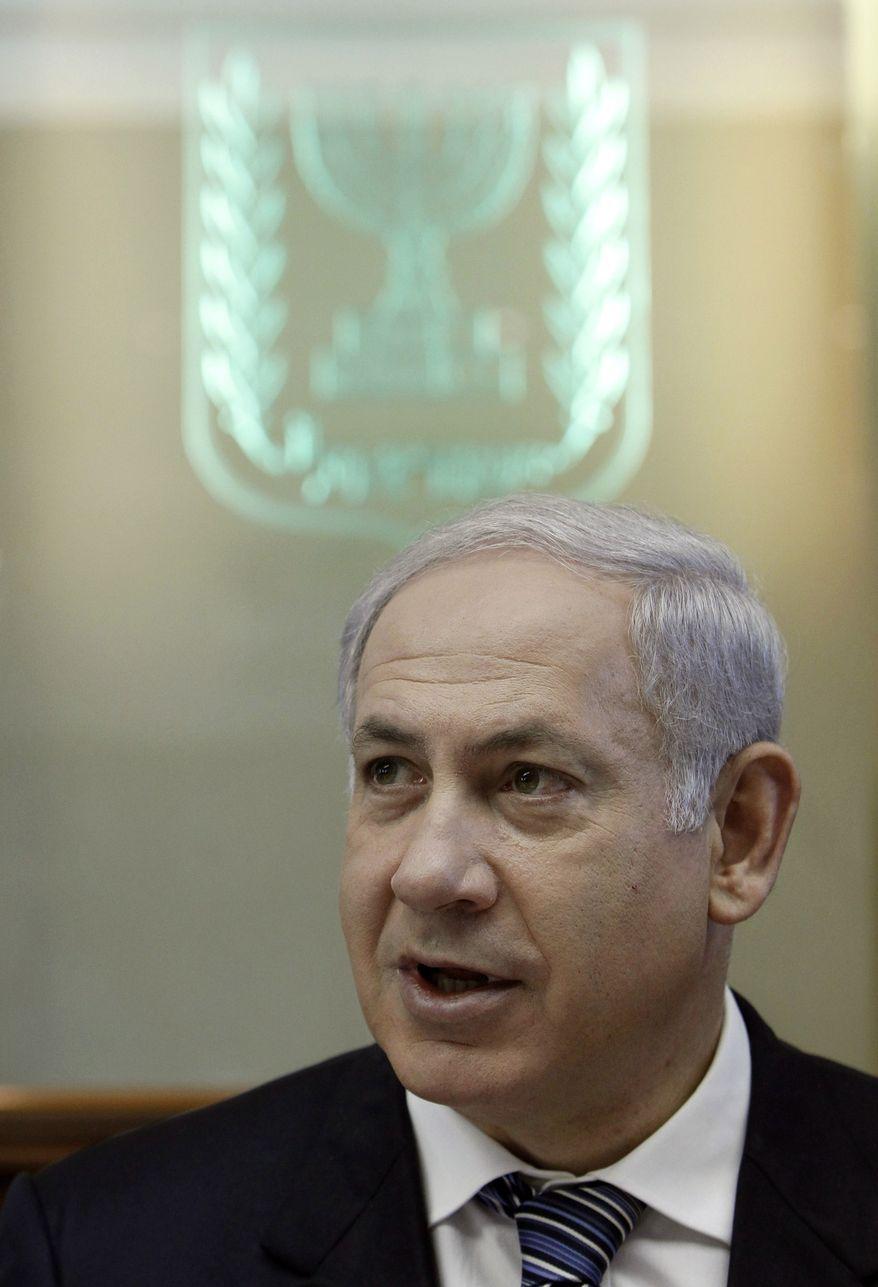 Israeli Prime Minister Benjamin Netanyahu attends the weekly cabinet meeting in Jerusalem, Monday, Oct. 4, 2010. (AP Photo/Ammar Awad , Pool)