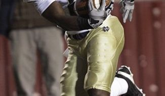 Notre Dame wide receiver Theo Riddick (6) steps toward the end zone for for their third first-quarter touchdown against  Boston College during their NCAA football game in Boston, Saturday night, Oct. 2, 2010. (AP Photo/Stephan Savoia)