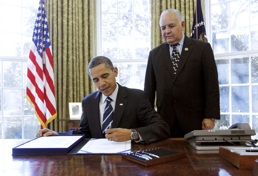 House Intelligence Committee Chairman Silvestre Reyes, Texas Democrat, watches as President Obama signs the Intelligence Authorization Bill, Thursday, Oct. 7, 2010, in the Oval Office of the White House in Washington . (AP Photo/Pablo Martinez Monsivais)