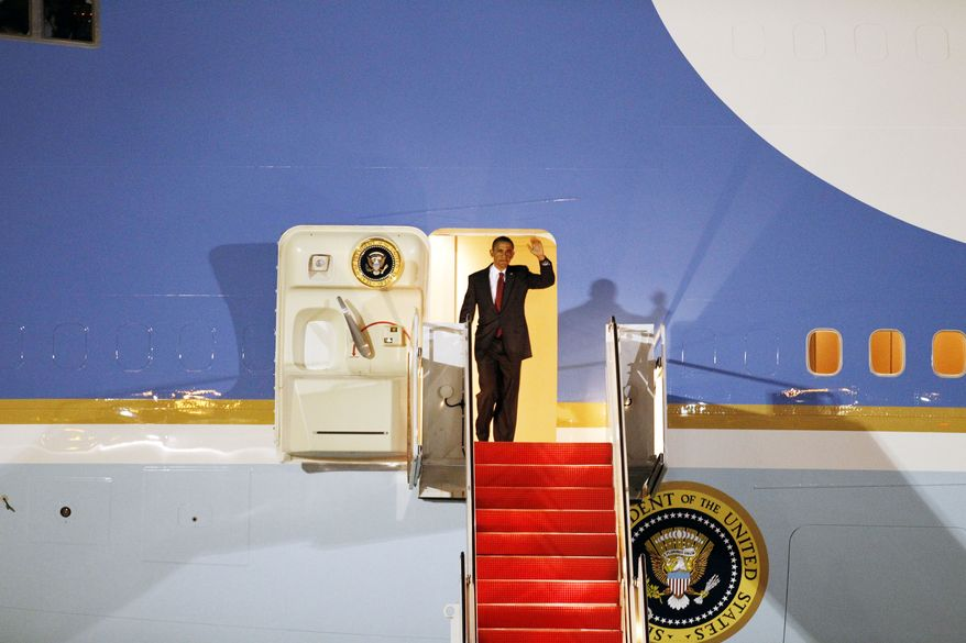 President Obama waves from Air Force One upon arrival at Andrews Air Force Base, Md., on Wednesday, Oct. 6, 2010. (AP Photo/Jose Luis Magana)