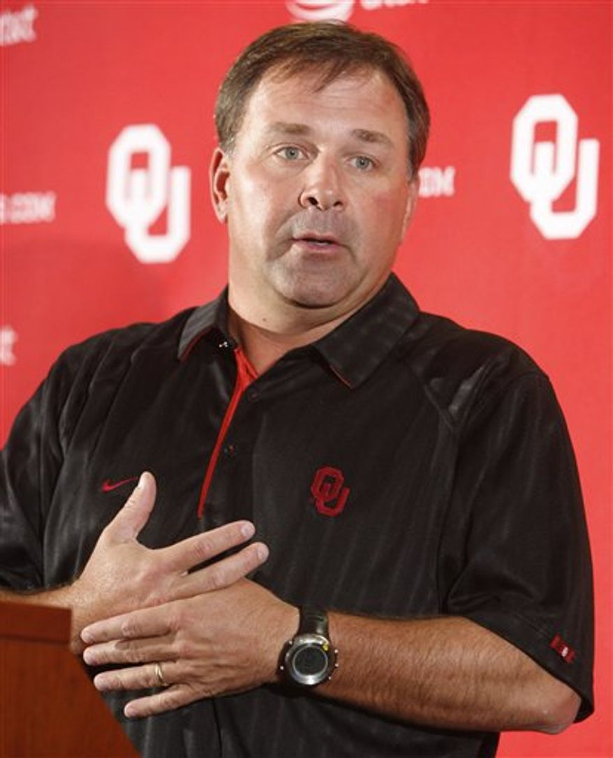 Oklahoma head football coach Bob Stoops gestures as he answers a question during an NCAA college news conference in Norman, Okla., Tuesday, Oct. 5, 2010. Stoops said that he has told his players there are numerous areas where the sixth-ranked Sooners need to get better during their off week before hosting Iowa State on Oct. 16. (AP Photo/Sue Ogrocki)