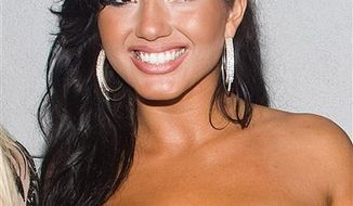 FILE - In this July 13, 2010 file photo, Girlicious member Natalie Mejia arrives to the Jersey Shore Soundtrack Release Party in New York. (AP Photo/Charles Sykes, file)