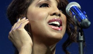 FILE - In this March 6, 2010 file photo, U.S. singer Toni Braxton performs during the Java Jazz concert festival in Jakarta, Indonesia. (AP Photo/Achmad Ibrahim, file)