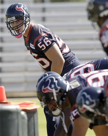 Houston Texans linebacker Brian Cushing (56) practices with teammates for the first time since the end of his four-game suspension, Wednesday, Oct. 6, 2010, in Houston. Cushing missed the Texans first four football games for violating the NFL's policy on banned substances. (AP Photo/David J. Phillip)