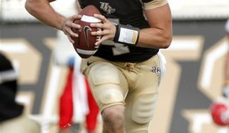 FILE - In this Sept. 11, 2010, file photo, Central Florida quarterback Jeffrey Godfrey (2) rolls out during the second half of an NCAA college football game against North Carolina State in Orlando, Fla. Central Florida hosts UAB on Wednesday. (AP Photo/Reinhold Matay, File)