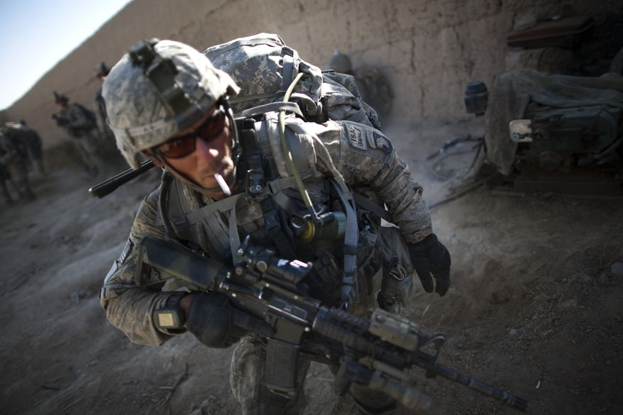 Sgt. Bill Myers, from Phoenix, Ariz., from Bravo Company 2-502 Infantry Regiment, 101st Airborne Division, prepares to patrol after a break near Forward Operation Base Howz-e-Madad, Zhari district, Kandahar province, Afghanistan, Thursday, Oct. 7, 2010. (AP Photo/Rodrigo Abd)