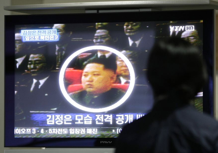 ** FILE** In this Oct. 1, 2010, file photo, a South Korean worker watches a TV news program showing North Korean leader Kim Jong Il's third son Kim Jong Un as she waits to head to the North Korean city of Kaesong at the customs, immigration and quarantine office for North Korea near the Demilitarized Zone (DMZ) of Panmunjom in Paju, South Korea. North Korean authorities confirmed to TV news agency APTN in Pyongyang that the man shown in the footage is Kim Jong Un. (AP Photo/Ahn Young-joon, File)