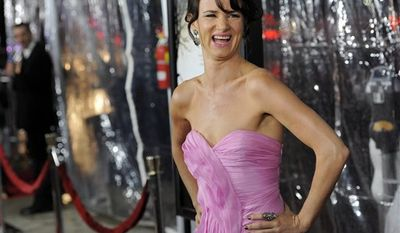 """Juliette Lewis, a cast member in """"Conviction,"""" poses at the premiere of the film in Beverly Hills, Calif., Tuesday, Oct. 5, 2010. (AP Photo/Chris Pizzello)"""