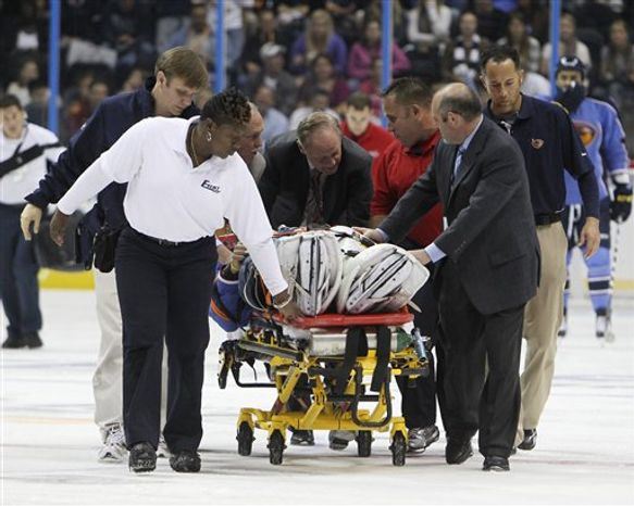 Atlanta Thrashers medical personal take Atlanta Thrashers goalie Ondrej Pavelec off the ice after he collapsed in the first period of an NHL hockey game against the Washington Capitals  Friday, Oct. 8, 2010 in Atlanta., (AP Photo/John Bazemore)