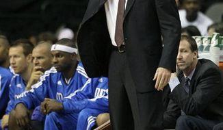 Dallas Mavericks head coach Rick Carlisle instructs his team in the first half of a NBA preseason basketball game against the Washington Wizards Tuesday, Oct. 5, 2010 in Dallas. The Wizards won 97-94. (AP Photo/Tony Gutierrez)