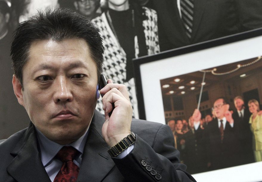 Shang Baojun, lawyer for Nobel Peace Prize winner Liu Xiaobo, calls his mobile phone to check whereabouts of Liu Xia, wife of Liu Xiaobo, during an interview in Beijing, China, on Saturday, Oct. 9, 2010. The world's newest Nobel Peace Prize winner remained unreachable in a Chinese prison Saturday, with his wife's mobile phone turned off and her own whereabouts -- in the company of police -- unknown. Concerns grew that an angry China might detain her as well. (AP Photo/Andy Wong)