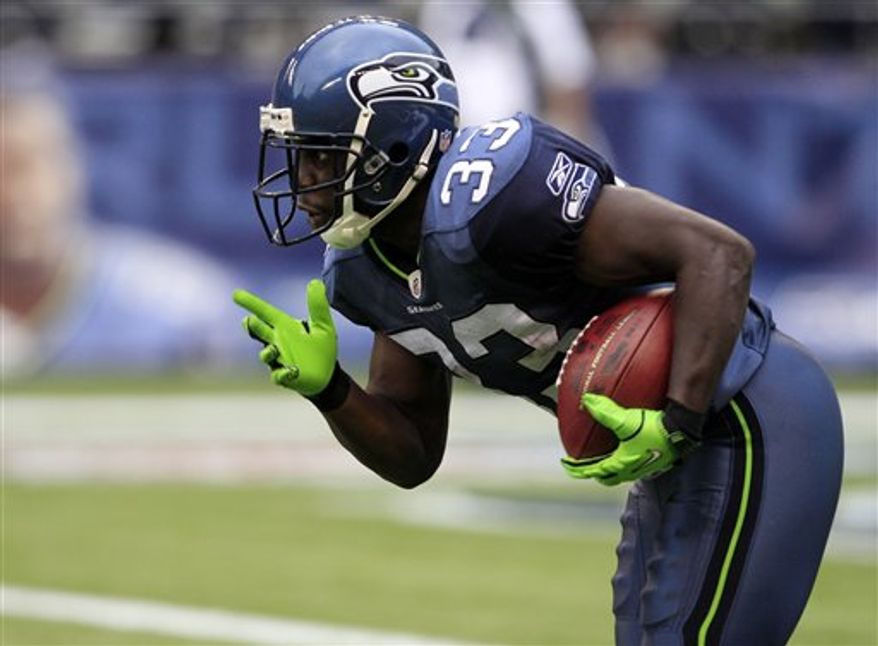 FILE - In this Sept. 26, 2010, file photo, Seattle Seahawks' Leon Washington begins his 99-yard kickoff return for a touchdown against the San Diego Chargers during the second half of an NFL football game,in Seattle. Washington returned two kickoffs for touchdowns, leading the Seahawks to a 27-20 win. (AP Photo/Elaine Thompson, File)