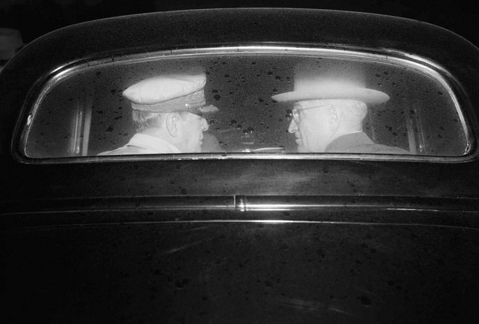 ** FILE ** This Oct. 14, 1950, file picture shows Gen. Douglas MacArthur, left, and President Harry Truman in an automobile during a meeting on Wake Island to discuss the Korean War. Truman later told reporters the atomic bombing of North Korea was under consideration. MacArthur had a plan to drop 30 to 50 of the bombs, the general told journalists after the war. Sixty years after the start of the Korean War, recently released declassified documents have helped fill in the history of U.S. nuclear threats against North Korea over the decades. (AP Photo/WA, File)