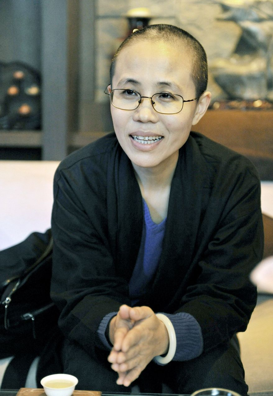 Liu Xia, wife of Chinese dissident Liu Xiaobo, is seen here Oct. 4, before her husband was awarded the Nobel Peace Prize. (Associated Press)