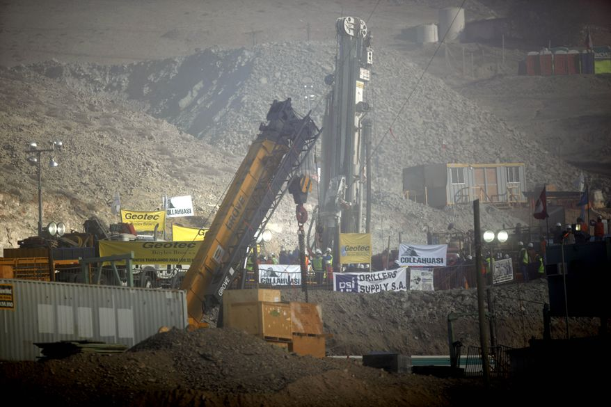 The T-130 drill is seen as a siren goes off announcing that the drill reached the trapped miners in the San Jose mine near Copiapo, Chile, on Saturday, Oct. 9, 2010. (AP Photo/Natacha Pisarenko)