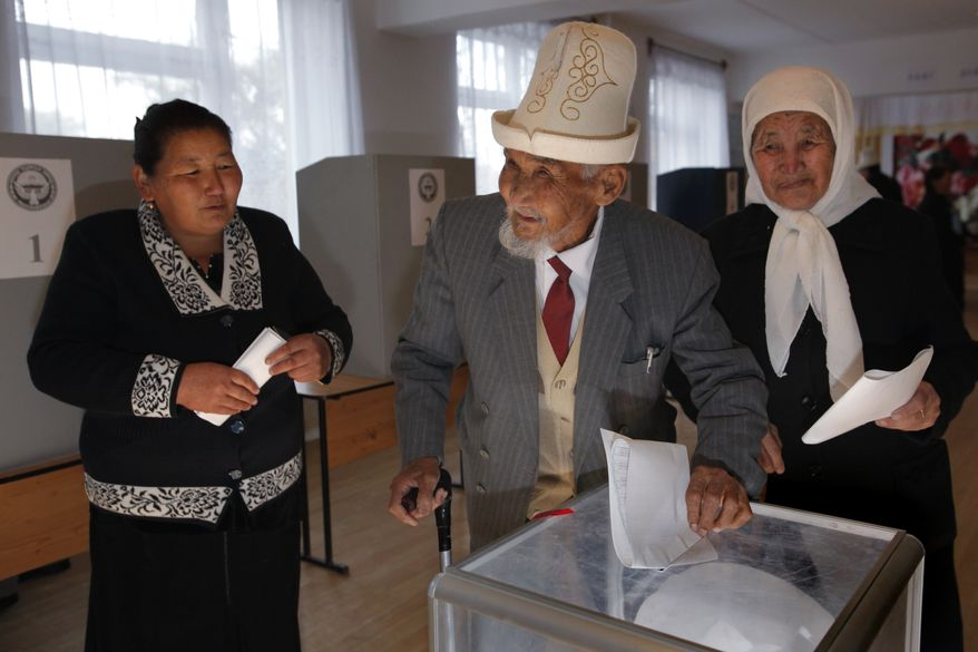 Kyrgyz voters cast their ballots at a polling station in the village of Arashan, 12 miles south of the capital of Bishkek, Kyrgyzstan, on Sunday, Oct. 10, 2010. (AP Photo/Alexander Zemlianichenko)