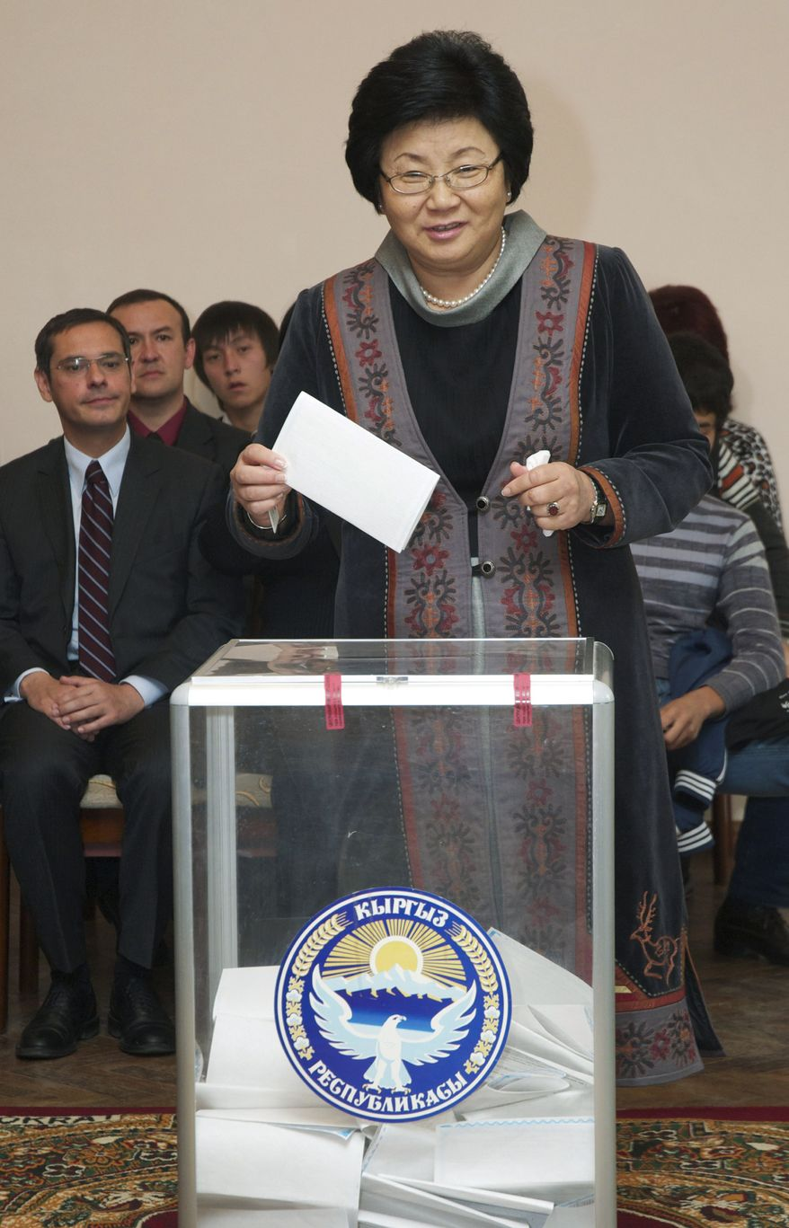 Kyrgyz President Roza Otunbayeva casts her ballot at a polling station in Bishkek, Kyrgyzstan, the nation's capital, on Sunday, Oct. 10, 2010. (AP Photo/Maxim Shubovich)