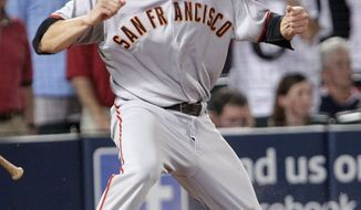 ASSOCIATED PRESS San Francisco Giants' Freddy Sanchez reacts after sliding into home with the go-ahead run on a ball hit by Buster Posey in the ninth inning against the Atlanta Braves in Game 3 of baseball's National League Division Series on Sunday, Oct. 10, 2010, in Atlanta. Braves second baseman Brooks Conrad was charged with an error on the play. The Giants won 3-2.