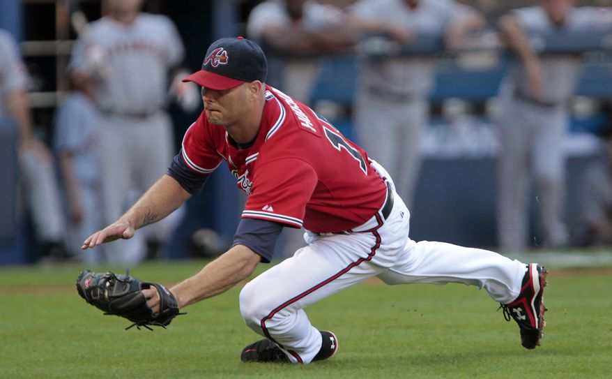 ASSOCIATED PRESS Atlanta Braves pitcher Tim Hudson catches a pop bunt by San Francisco Giants' Jonathan Sanchez in the second inning of Game 3 of baseball's National League Division Series on Sunday, Oct. 10, 2010, in Atlanta.