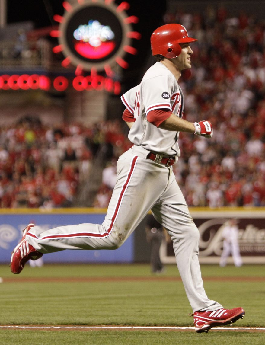 ASSOCIATED PRESS Philadelphia Phillies' Chase Utley trots home after a solo home run off Cincinnati Reds starting pitcher Johnny Cueto in the fifth inning of Game 3 of baseball's National League Division Series Sunday, Oct. 10, 2010, in Cincinnati.