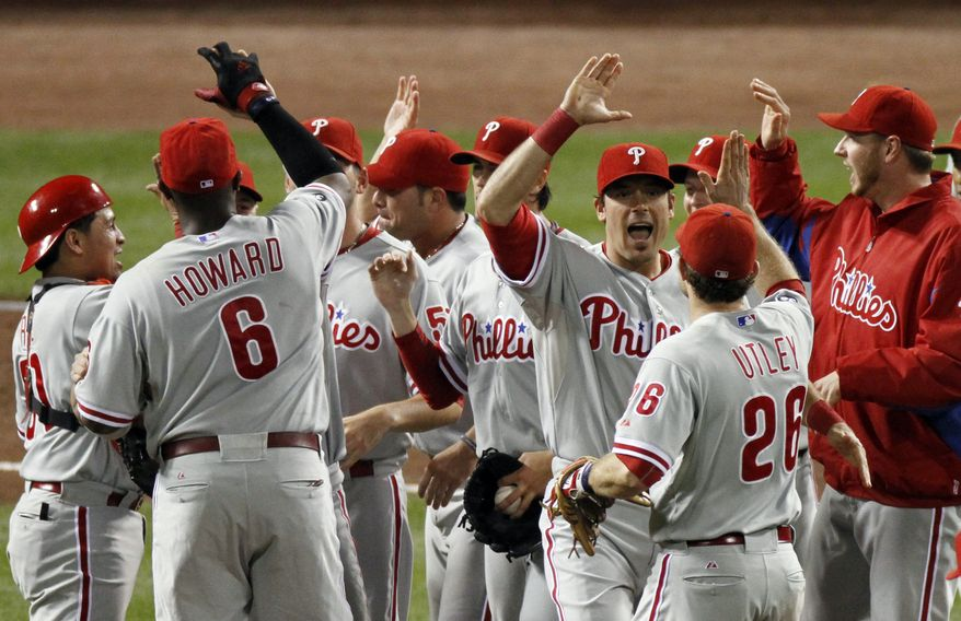 ASSOCIATED PRESS The Philadelphia Phillies celebrate after beating the Cincinnati Reds 2-0 in Game 3 of baseball's National League Division Series Sunday, Oct. 10, 2010, in Cincinnati. Philadelphia swept the reds 3-0 to advance to the National League Championship Series.