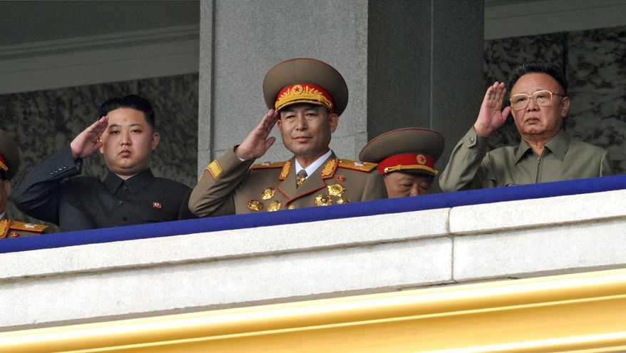 ** FILE ** North Korea leader Kim Jong-il (right) and his son Kim Jong-un (left) salute from a balcony as they attend a massive military parade marking the 65th anniversary of the communist nation's ruling Workers' Party in Pyongyang, North Korea, on Sunday, Oct. 10, 2010. This year's celebration came less than two weeks after Kim Jong-il's re-election to the party's top post and the news that his 20-something son would succeed his father and grandfather as leader. (AP Photo/Kyodo News)