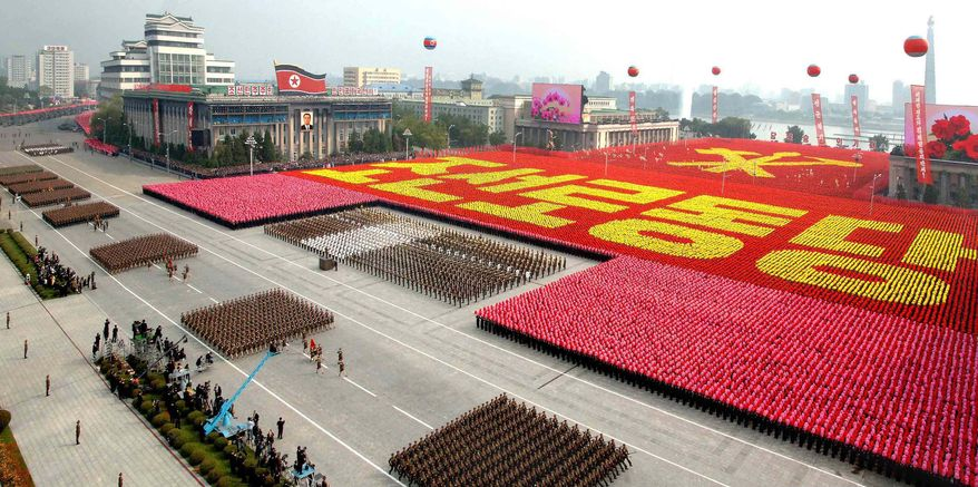 North Korean military personnel march during a massive parade marking the 65th anniversary of the communist nation's ruling Workers' Party in Pyongyang, North Korea, on Sunday, Oct. 10, 2010. (AP Photo/Korean Central News Agency via Korea News Service)