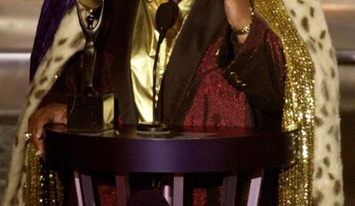 ** FILE ** Solomon Burke, one of the pioneers of soul music, gestures to the audience after being inducted into the Rock and Roll Hall of Fame in March 2001 in New York. Mr. Burke died at Amsterdam's Schiphol Airport on Sunday, Oct. 10, 2010, at age 70. (AP Photo/Kathy Willens)