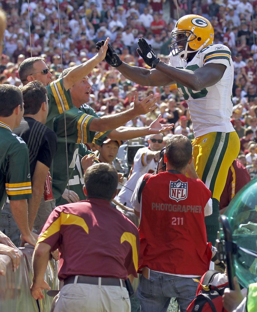 ASSOCIATED PRESS Green Bay Packers tight end Donald Lee celebrates his touchdown with fans during the first half of an NFL football game against the Washington Redskins in Landover, Md., Sunday, Oct. 10, 2010.