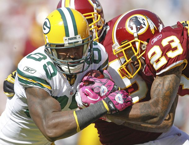 ASSOCIATED PRESS Green Bay Packers tight end Donald Lee, left, pushes across the goal line to score a touchdown under pressure from Washington Redskins cornerback DeAngelo Hall during the first half of an NFL football game in Landover, Md., Sunday, Oct. 10, 2010.
