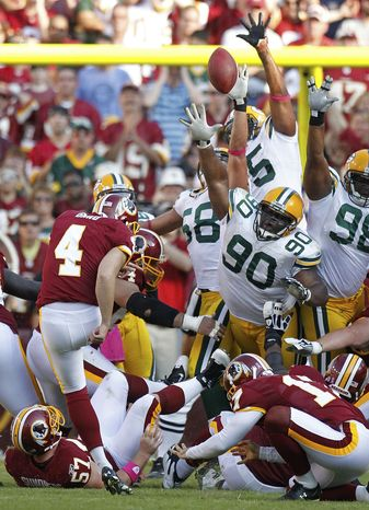 ASSOCIATED PRESS Washington Redskins' Graham Gano (4) kicks a field goal to win the game during overtime of an NFL football game against the Green Bay Packers in Landover, Md., Sunday, Oct. 10, 2010. The Redskins won 16-13.