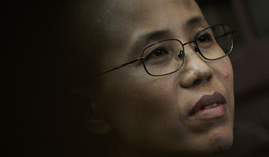 ** FILE ** Liu Xia, wife of jailed Chinese dissident Liu Xiaobo, who won this year's Nobel Peace Prize, is shown during an interview with the Associated Press in Beijing on Sept. 28, 2010. Mrs. Liu said in a Twitter message that she has been under house arrest since Friday, Oct. 8, 2010. (AP Photo/Andy Wong, File)